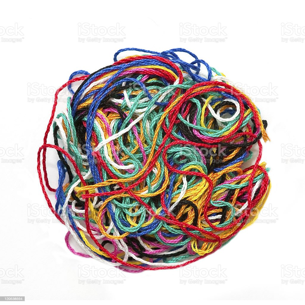 Circle of different colors of tangled thread stock photo