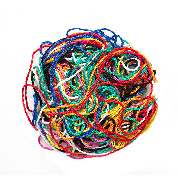 circle of different colors of tangled thread - tangled stock photos and pictures