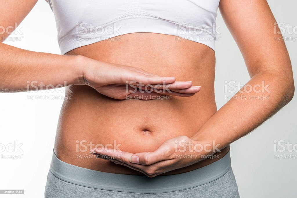 circle of hands on stomach stock photo