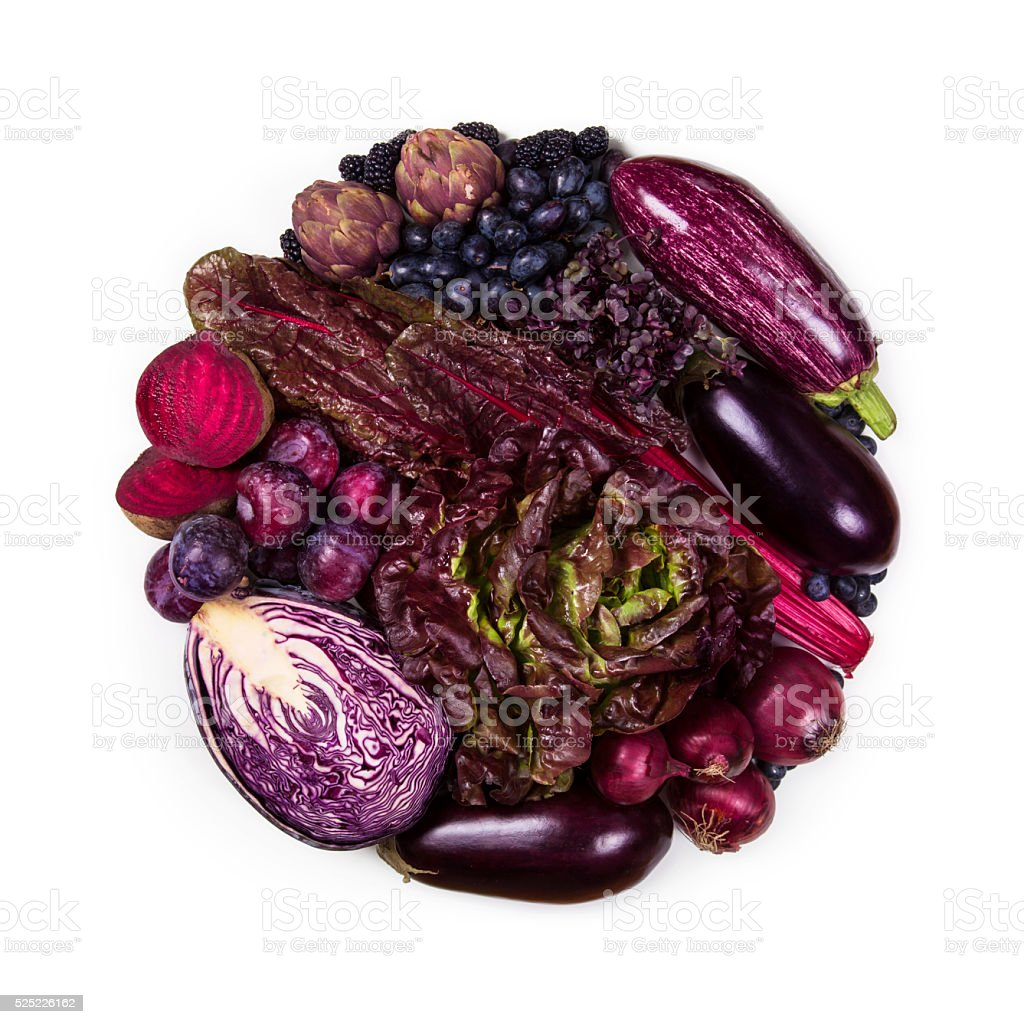 Circle of purple and blue fruits and vegetables stock photo