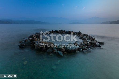 Circle shape of rocks in Sprout Lake located on central Vancouver Island.