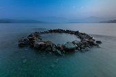 istock Circle Of Rocks In The Lake 1277062455