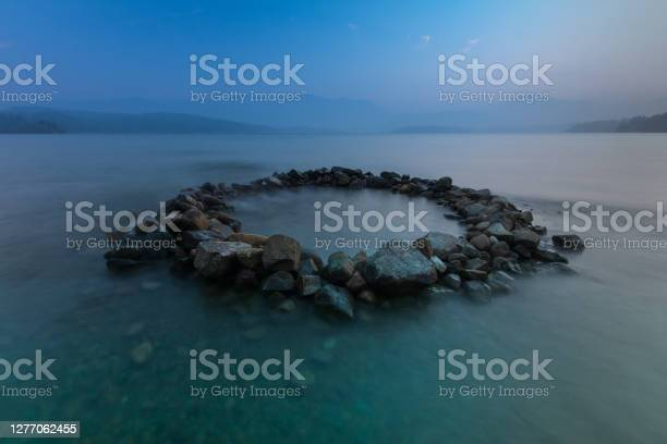 Photo of Circle Of Rocks In The Lake