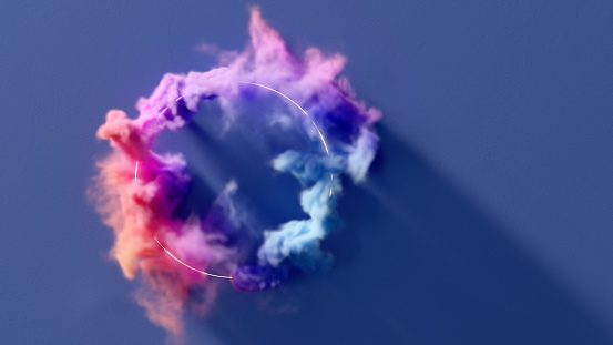 Colorful smoke flowing around a glowing ring