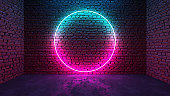 Circle shaped glowing neon frame on brick wall in dark room. Blue to purple or pink gradient color glow. Sci-fi, cyberpunk and disco concept. 3D illustration.