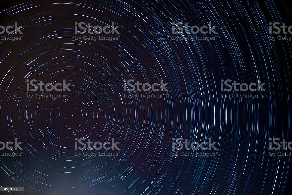 circle star trail at the north pole stars stock photo