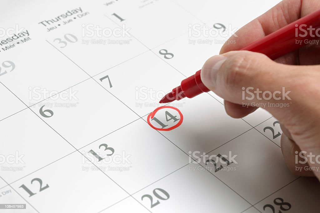 A circled date on a large calendar in red ink stock photo