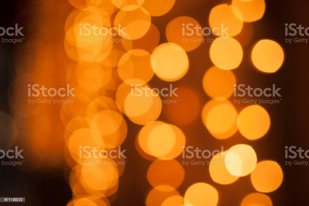 Circles of yellow lights out of focus stock photo