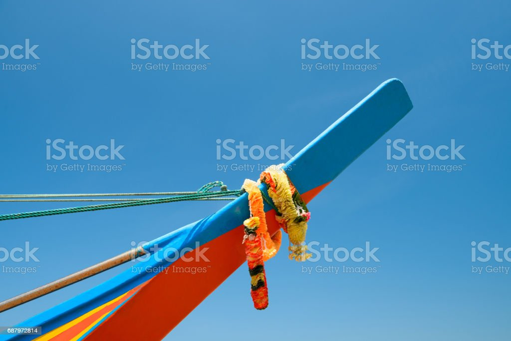 Circlet of flowers on traditional boat stock photo