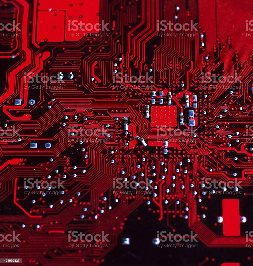 Circuit board background in red stock photo