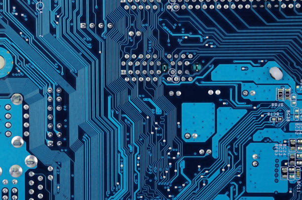 Circuit board background Close up of old printed blue computer circuit board circuit board stock pictures, royalty-free photos & images