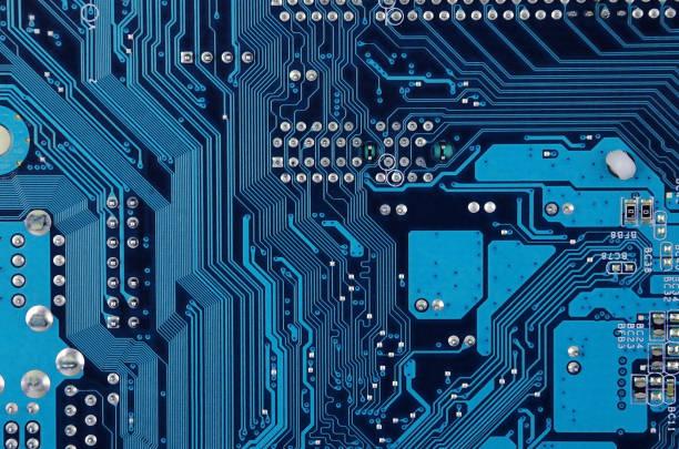 circuit board background - ingrandimento foto e immagini stock