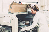 Woman working in production factory