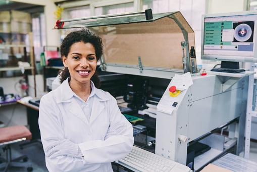 Portrait of woman working as maintenance engineer