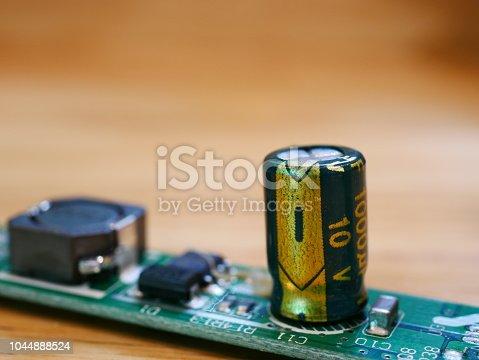istock Circuit Board with capacitors taken closeup 1044888524