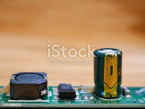 istock Circuit Board with capacitors taken closeup 1044888534