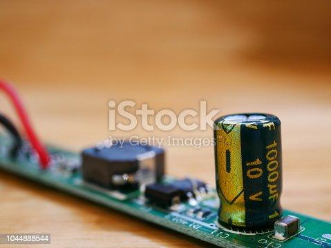 istock Circuit Board with capacitors taken closeup 1044888544