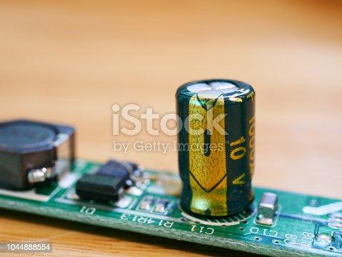 istock Circuit Board with capacitors taken closeup 1044888554