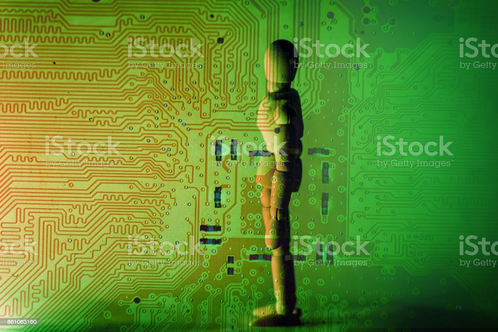 CPU circuit board with wooden figurine - foto stock