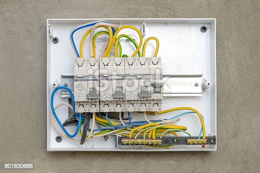 istock Circuit breakers in a plastic box on a wall 801830686