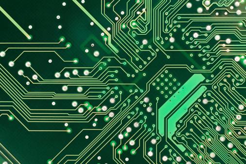 A close up of a green computer circuit.