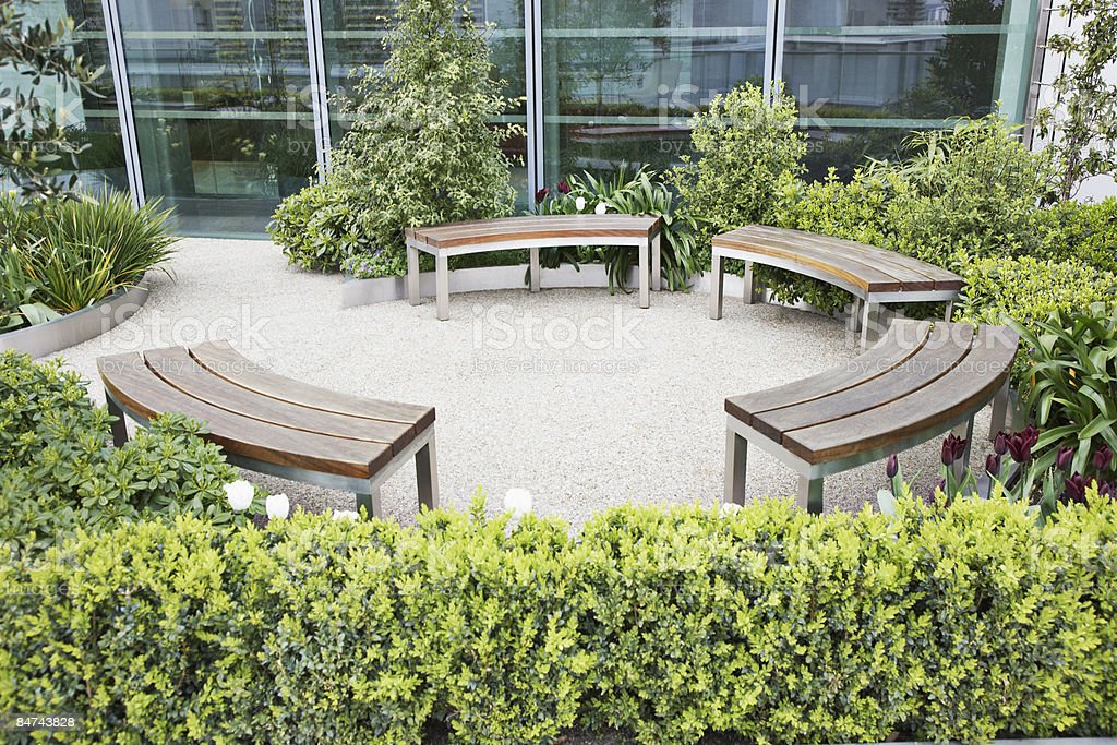 Circular benches in courtyard stock photo