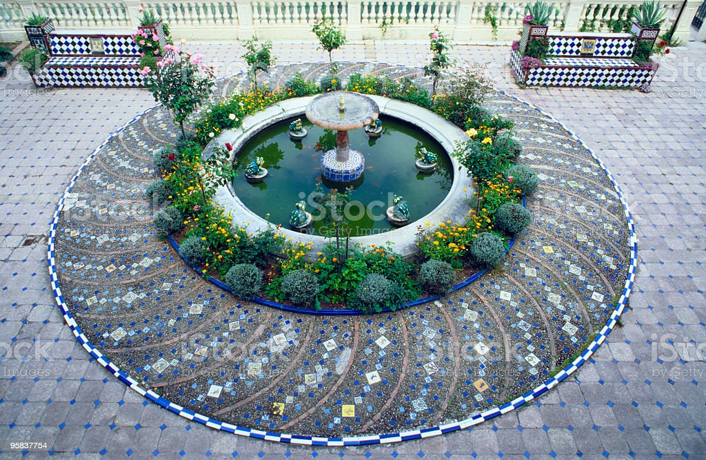 Circular fountain with two benches. royalty-free stock photo