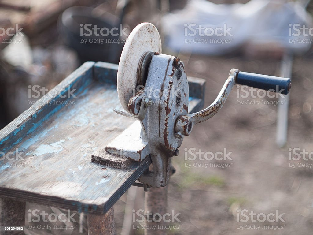 Circular grindstone on  serious wooden stand . Very vintage work tool stock photo