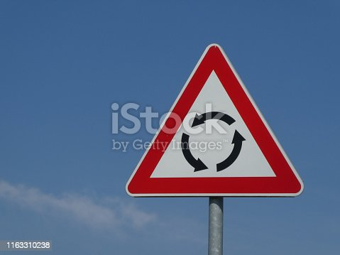 istock Circular Intersection warning traffic road sign roundabout 1163310238