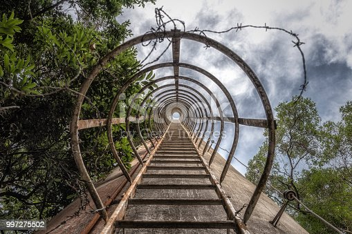 istock Circular Ladder to top of tower, bottom view 997275502