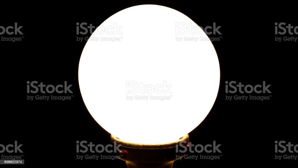 Circular lamp on black background stock photo