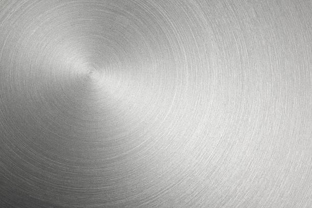 Circular Metal Brushed Texture Circular stainless steel brushed background. brushed metal stock pictures, royalty-free photos & images