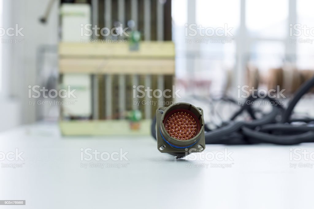 Circular multi-pin connector lie on the table stock photo