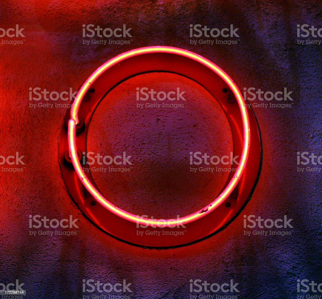 Circular neon light mounted on a wall stock photo