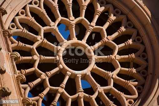 An abstract closeup detail of a circular design in the tower of a cathedral in Zacatecas, Mexico.