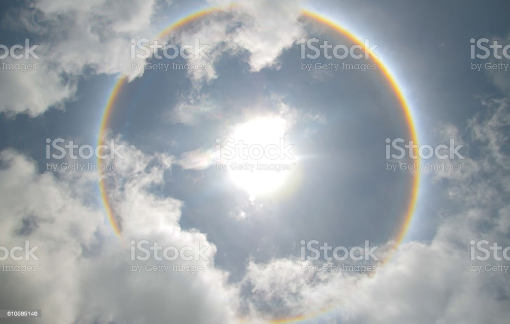 circular rainbow  sun halo occurring due to ice crystal stock photo