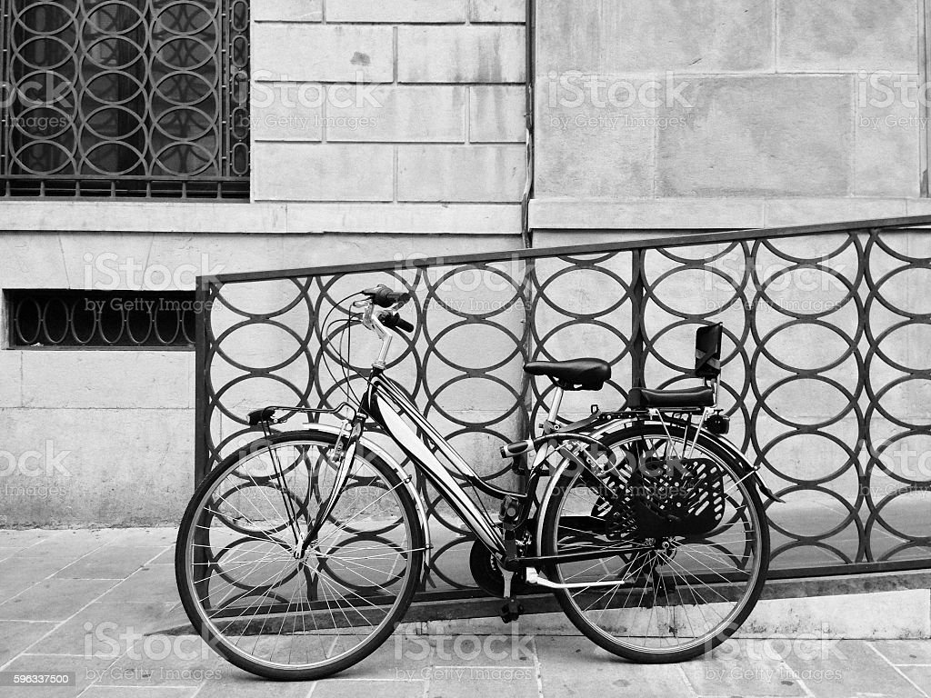 Circular repeting patterns and a parked bicycle royalty-free stock photo