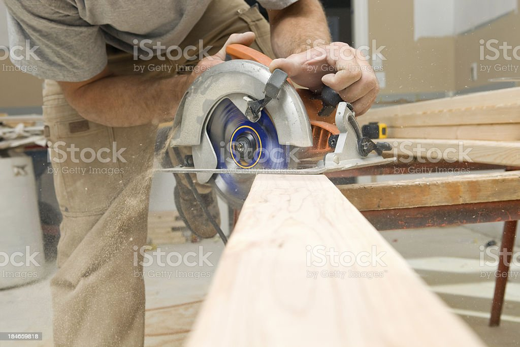 Circular Saw Cuts Stud for Home Remodeling Project royalty-free stock photo