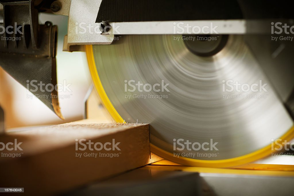 Circular Saw Cutting a Wood Plank stock photo