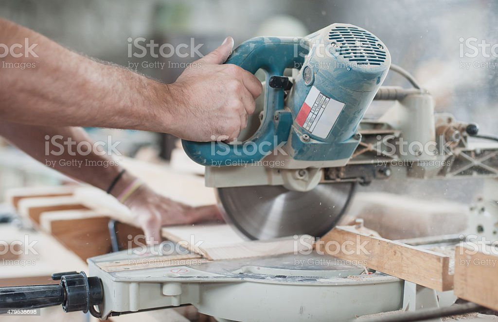 Circular Saw Carpenter Using Circular Saw for wood 2015 Stock Photo
