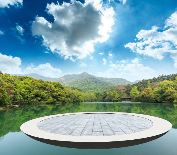 circular square and mountain with water nature landscape stock photo