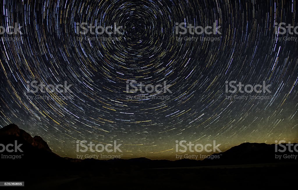Circular Star Trail over Mountains stock photo
