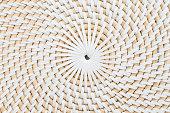 Circular straw surface.