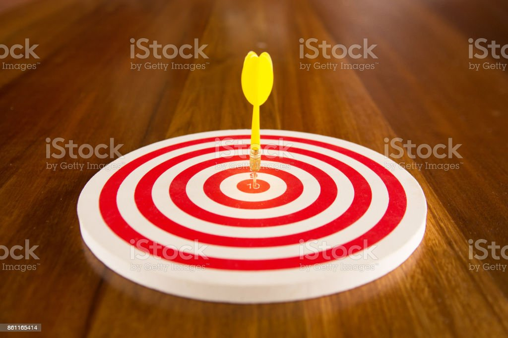 Circular target marked with numbers and dart. stock photo