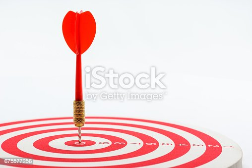 istock Circular target marked with numbers and red dart. 675577256