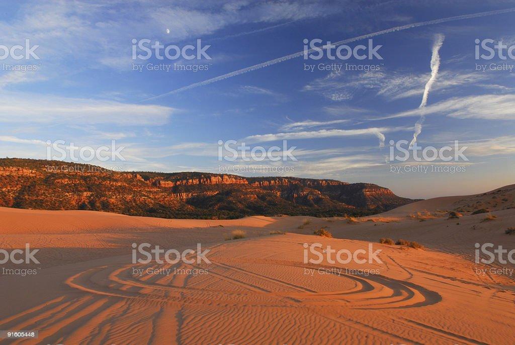 Circular tire tracks in desert sand dunes stock photo