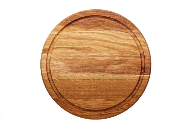 circular wooden cutting board - разделочная доска стоковые фото и изображения