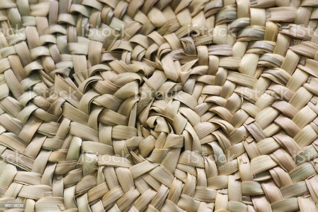 Circular woven straw background in beige and sand colors royalty-free stock photo