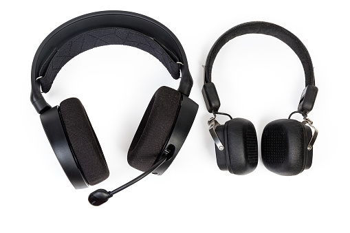 High-fidelity headset with ear pads circumaural type and headphones with ear pads supra-aural type on a white background, top view
