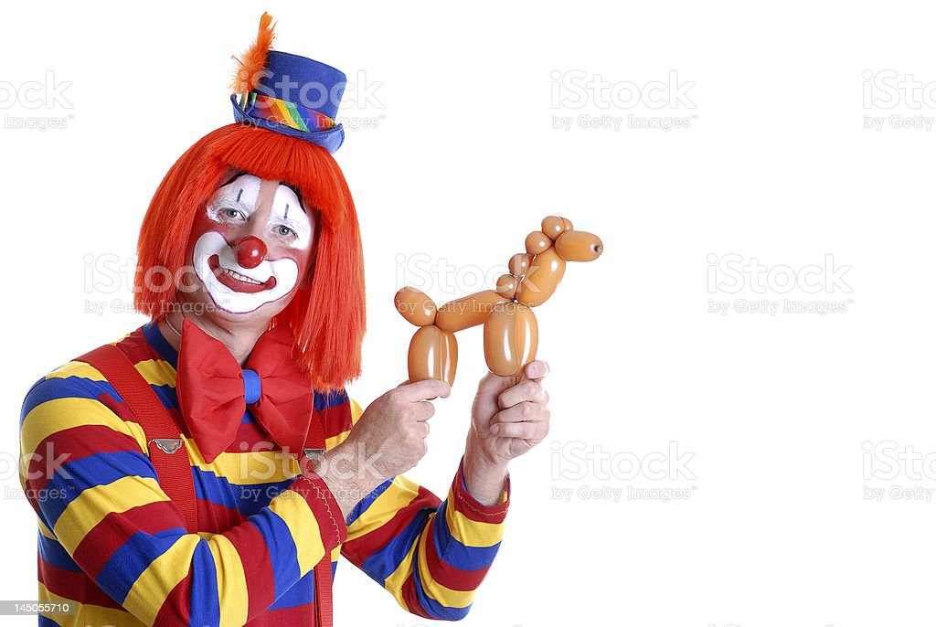 Circus Clown Displaying a Horse Balloon Animal stock photo